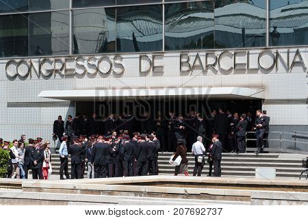 Barcelona, Spain - APRIL 16, 2013: Policemen (Mossos) in the town of Barcelona. The Mossos Esquadra is a police force that operates only in Catalonia