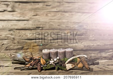Merry Christmas decoration advent with burning grey candle Blurred background snow text space message 1st