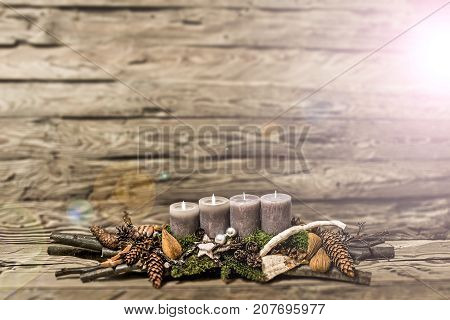 Merry Christmas decoration advent with burning grey candle Blurred background text space message 2nd