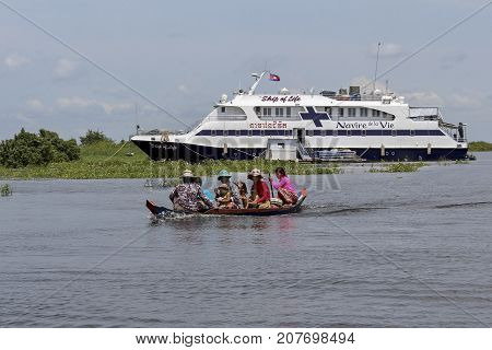 Tongle Sap Lake, Cambodia: October 5, 2012: A small boat of unidentified Cambodians leaving the Ship of Life.