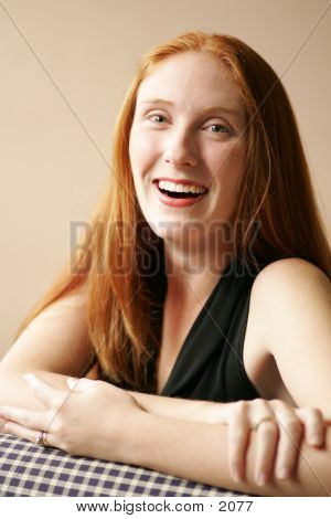 young woman with auburn hair and happy smile poster