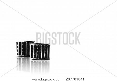 black cufflinks on a white background closeup with reflection