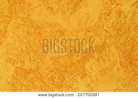 Background of golden textured surface. Golden texture for design and web background. Shiny golden surface of concrete wall.