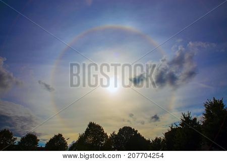 Circular rainbow around the sun. Halo. A rare atmospheric phenomenon. poster