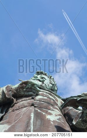 Statue of Kisfaludy Karoly in Gyor under the Blue Sky