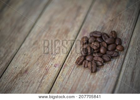 Coffee Beans On Wooden Table In A Coffee Shop