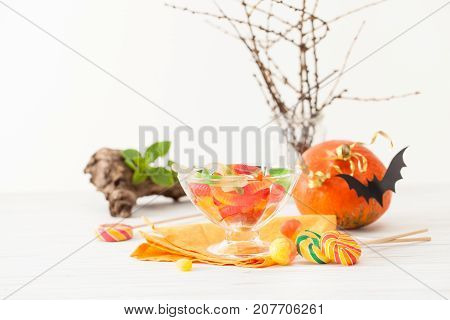 Candy In Vases On The Table Decorated For Halloween