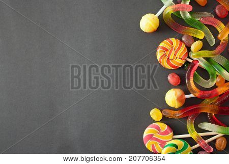 Caramel And Worms For Halloween On Black Background
