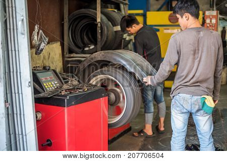 Checking A Car Wheel For Repair At Car Garage