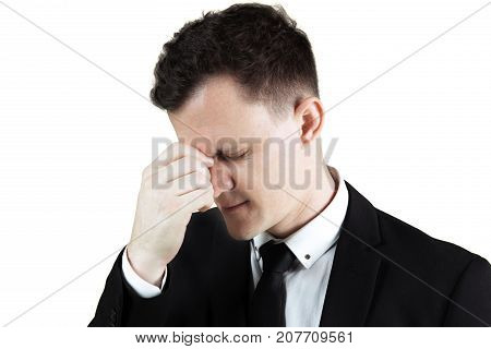 Portrait of a stressful young businessman shrink his forehead while wearing formal suit isolated on white background