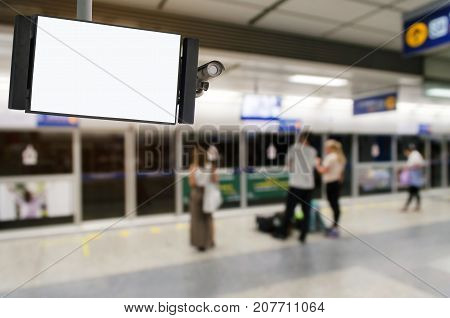 CCTV and LCD TV with white blank screen copy space for advertising or media and content marketing with people waiting for subway at train station transportation marketing and advertising concept