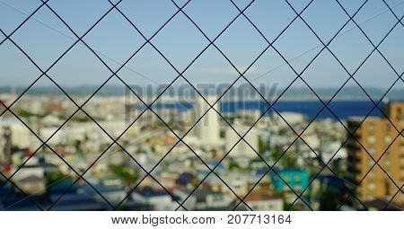 Glass window with cityscape background in sunny day.