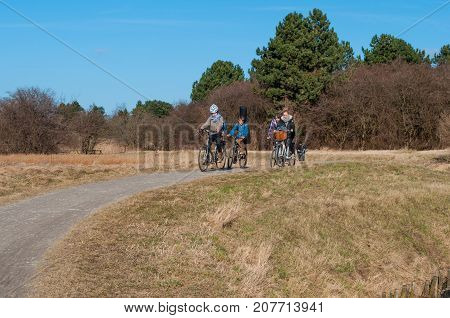 Family Bicycling Through The Danish Nature