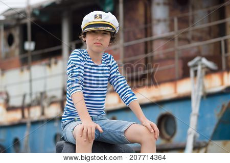 Portrait of a boy in a vest (Telnyashka) and captain's cap.