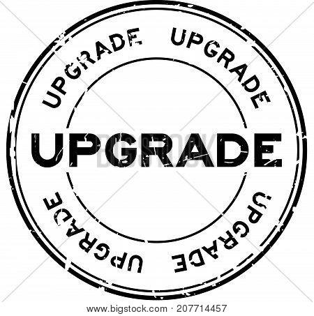Grunge black upgrade wording round rubber seal stamp on white background