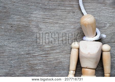 Wood figure with the rope in noose shape and have the copy space (Concept for working or emotional stress)