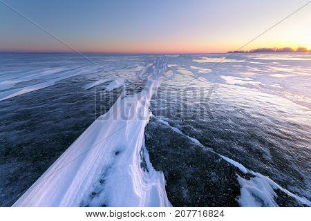 dawn of winter the snow-covered ice / bright dawn frozen lake landscape