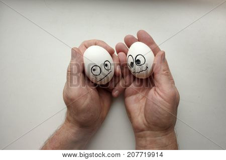 Diffidence Concept. Funny Eggs On A Hand Together
