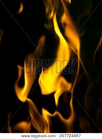 face on fire on a black background