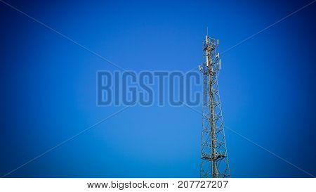 Radio Telecom tower pole over the blue sky background with copy space.