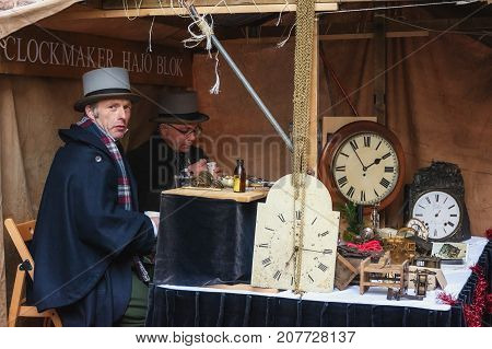 Deventer Netherlands - December 18 2016: clockmakers at work during the festival at the Dickens Festval in Deventer