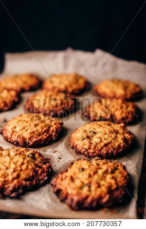 Homemade Oatmeal Cookies with Raisins on Parchment Paper. Vertical Orientatio and Copy Space.
