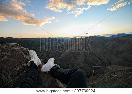 Feet Overlooking Mountain Sunset in Rocky Mountains Park