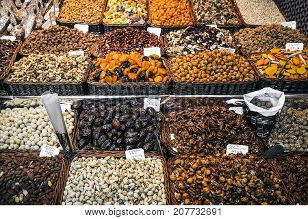 dried fruits and nuts deli stall display at la boqueria market in barcelona spain