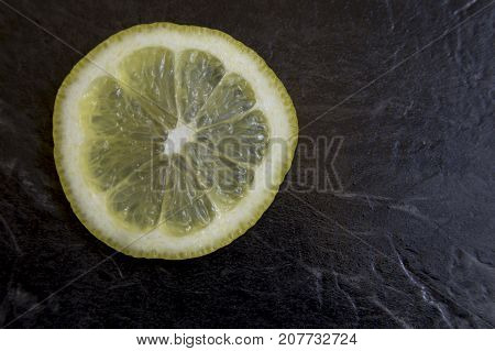 Lemon Slice On Black Marble