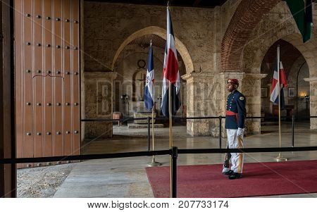 SANTO DOMINGO DOMINICAN REPUBLIC - SEPTEMBER 10 2017: Guard on duty remains immobile for hours guarding the entrance of the national pantheon.