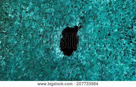 Broken transparent glass into small pieces .