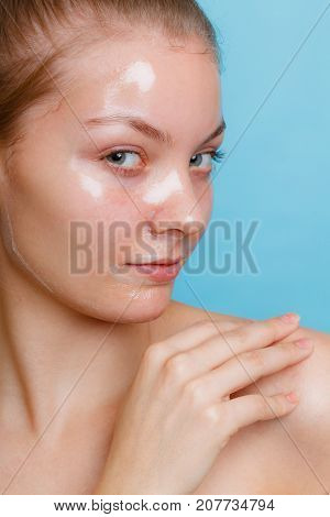 Woman In Facial Peel Off Mask.