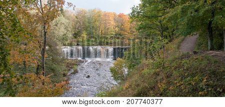 Keila-Joa waterfall and river in golden autumn red and yellow colors. Nice panorama, good backround image.
