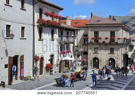 PESCOCOSTANZO ITALY - AUGUST 21 2015: people walk to Pescocostanzo on the mountain village - about 1400 m above sea - Pescocostanzo in the region of Abruzzo Italy