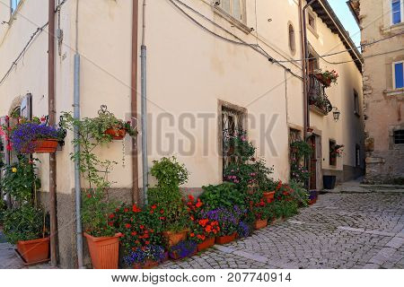 Nice facades in steep alley. The mountain village - about 1400 m above sea - Pescocostanzo in the region of Abruzzo Italy