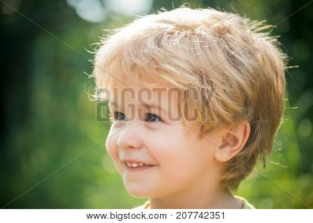 Happy child portrait boy smiling and looking away. Smile and happiness happy childhood. Child's face close up. People Portrait. Funny little boy 3 years old. Portrait beautiful blond preschool kid