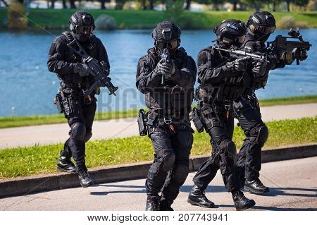 Special Forces Tactical Team Of Four In Action