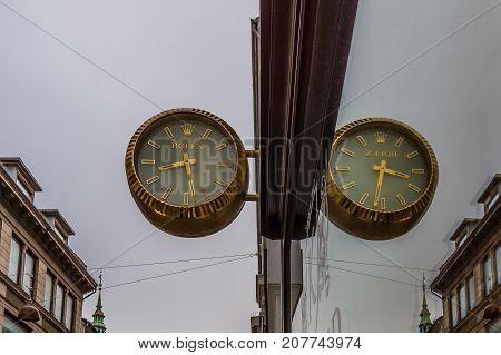 Rolex symbol refections in a window pane Copenhagen October 5 2017