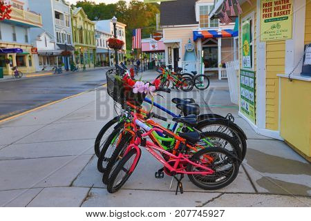 MACKINAC ISLAND, MICHIGAN - SEPTEMBER 12, 2017:  Bikes are a major form of transportation on Mackinac Island, Michigan.  This is a popular vacation destination.