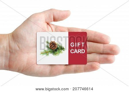 Christmas gift card in hand isolated on white background