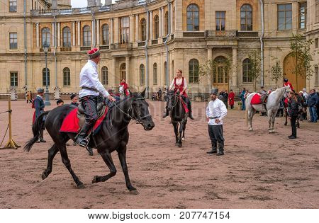 Gatchina St. Petersburg Russia - September 30 2017: Horse show of Cossacks on the parade ground of the Gatchina Palace. Cossacks artists are preparing for the tricks.