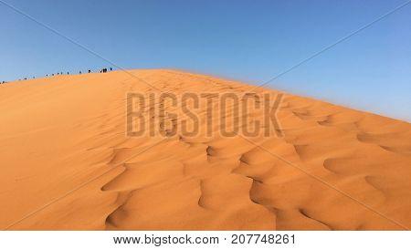 Hiking up Dune 45 in Namib-Naukluft National Park, Namibia