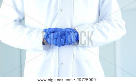 Research Scientist Hands In Gloves Holding Eachother, Gesture