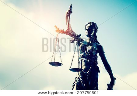 Lady justice themis statue of justice on sky background. law attorney court lawyer judge courtroom legal lady concept