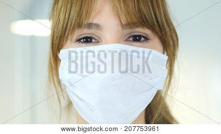 Close Up Of Female Reseach Scientist, Doctor In Mask