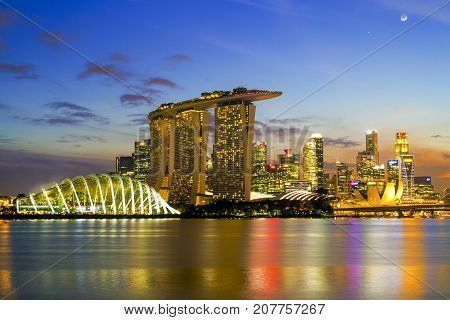 SINGAPORE CITY SINGAPORE: Sep 292017: Singapore Skyline. Singapore`s business district marina bay sand and the garden by the bay on sunset.