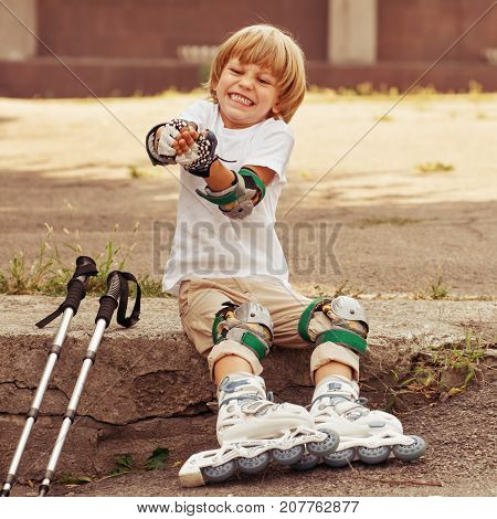 Young roller skater taking off his protection equipment after skating, image with toning