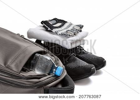 Fitness equipment including shoes, towel, gloves, bag and bottle of water