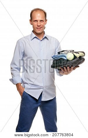 Portrait of happy young man holding change clothes for fitness