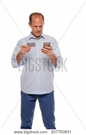 Portrait of man typing the phone number from the business card